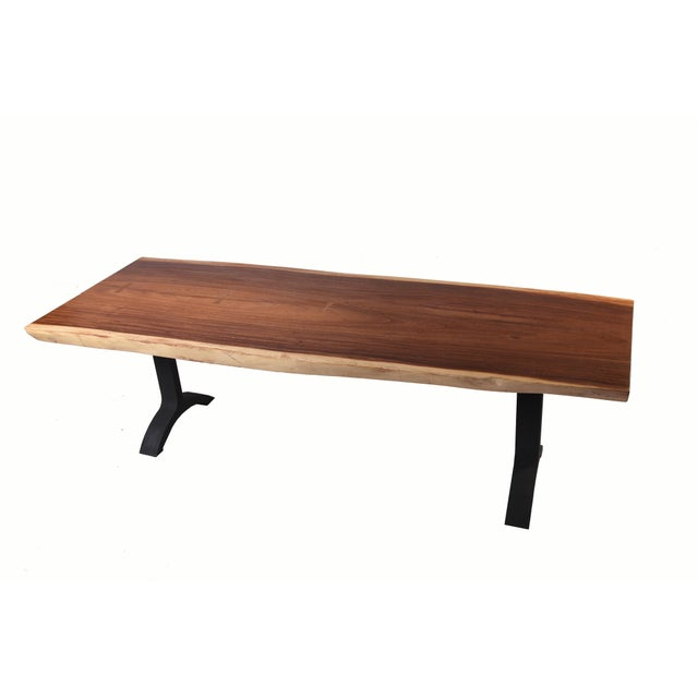 Simple and elegant modern design. The top of this large dining table is hand polished to show beautiful natural wood...