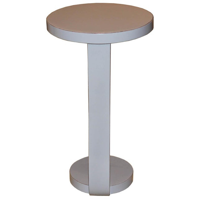 Contemporary small round cocktail table with exposed wood edges can be used as a coffee table or side tables next to an...