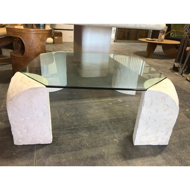 Stylish 1980's plaster base coffee table with glass top.