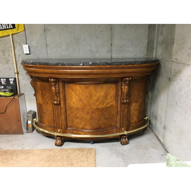-A laminated Italian marble top surface for serving drinks on this demilune (half-moon) shaped bar. -Additional features...