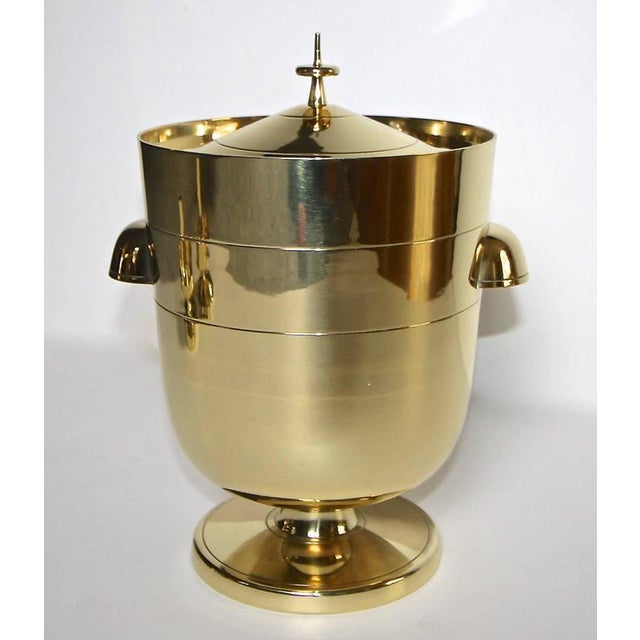 A tall modern ice or champagne bucket designed by Tommi Pazinger for Dorlyn Silversmiths, New York. This piece features...