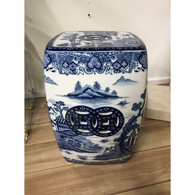 Gorgeous blue and white ceramic garden stool elaborately hand-decorated throughout with Asian pagoda scenes. Great accent...
