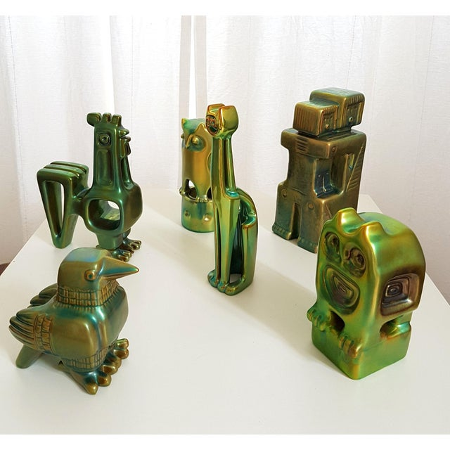 Set of six green eosin ceramic figurines, by Zsolnay, Hungary. Cubic period, with 1960s stamps under each piece. Each in...