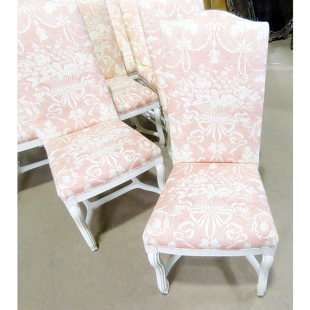 Set of 10 distressed painted Louis XV style upholstered dining side chairs.