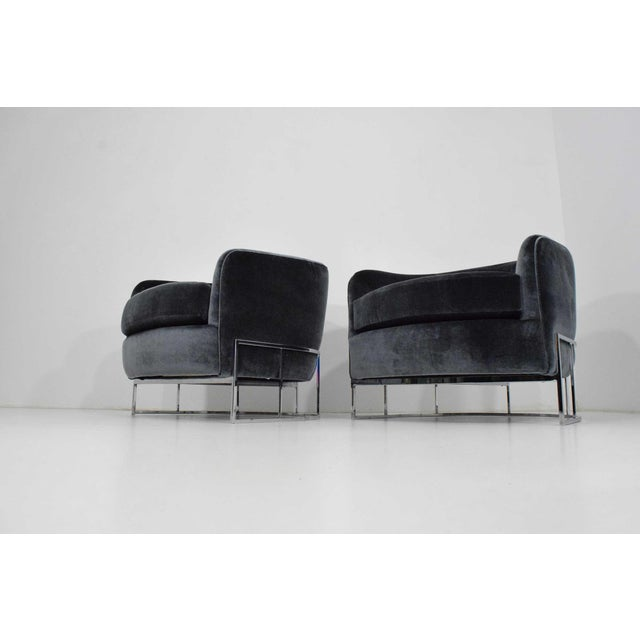 Newly upholstered in luxurious fabric by Dominique Keiffer for Rubelli. Fabric is Velours, color Gris. Chairs have a...