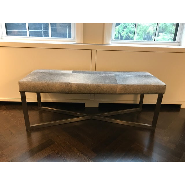 Beautiful Made Goods antiqued silver bench with gray hair-on-hide. The criss-crossed base has a minimalist feel while the...