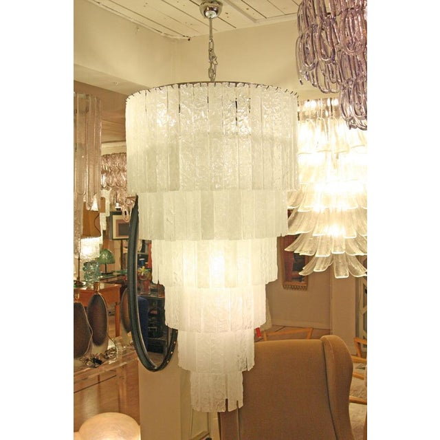 A six tiers ceiling light . ice color Blown glass components, 10 light bulbs on a steel chromed structure. STECCHE...