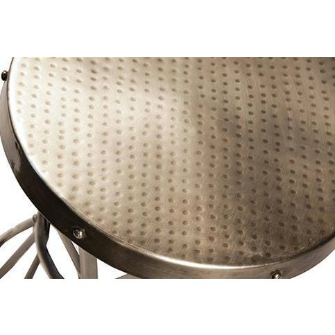 Round metal side table with X pattern base and metal straps. Hammered top with stud details around edges. Industrial and...