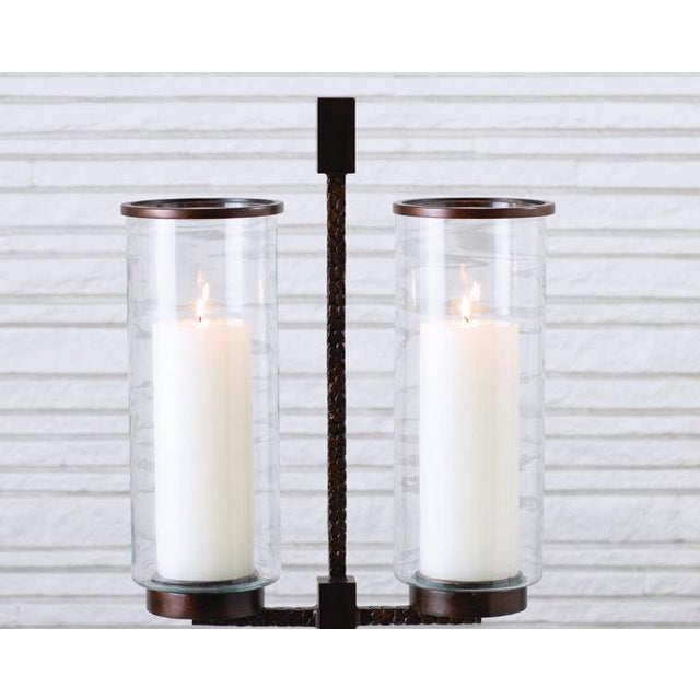"""Magnificently textured with a pebble like pattern. Iron base with antique bronze finish. Holds two 4""""Dia. Pillar Candle...."""