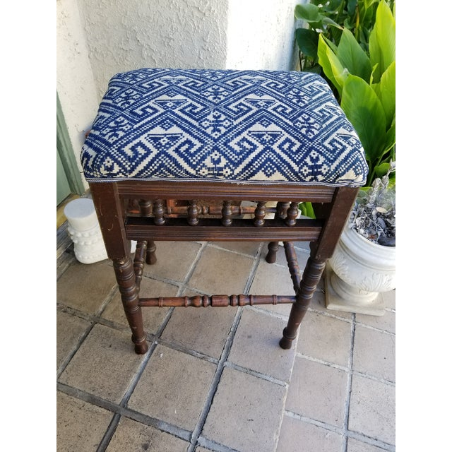 An English Antique wooden footstool. Newly recovered with vintage hand embroidered tribal design textile. Circa 1930.