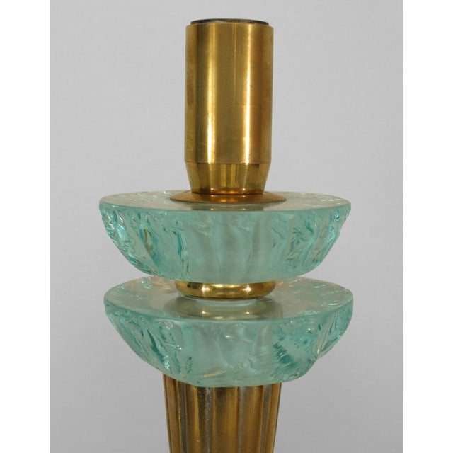2 Pair of French Art Deco brass single arm wall sconce with a fluted cornucopia form and round backplate supporting 2...