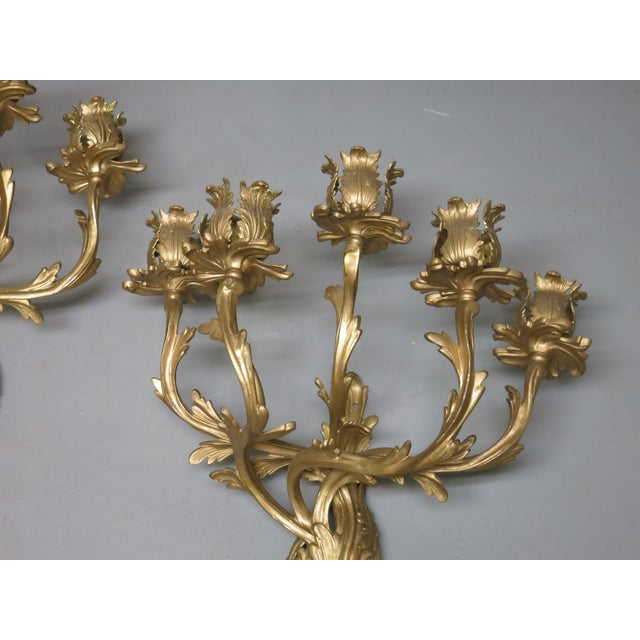 Beautiful pair of gilt French wall sconces. They are matte and polished brass. They need to be wired and fitted with...