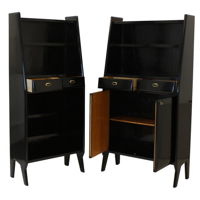 A large pair of stylish Italian bookcases in black lacquered cherry wood, each with shelves, drawers and a lockable...