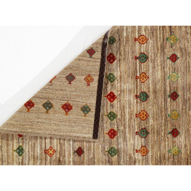 Gorgeous Persian Gabbeh rug. Hand-knotted. Hand-spun wool. Fine lamb's wool. The lovely piece of your home. This rug has a...