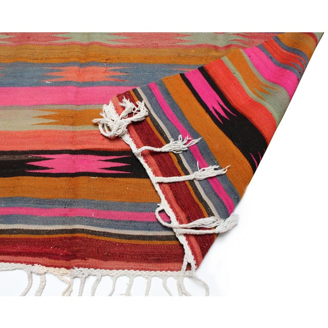 Vintage Anatolian kilim rug in pinks, purples, and blues. Two sided, one side has more muted colors than the reverse....
