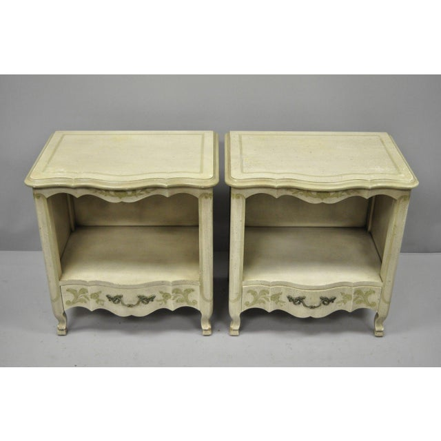Pair of John Widdicomb Country French Provincial Cream Painted Nightstands. Item features one dovetailed drawer each,...