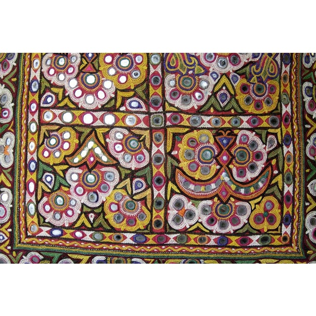 This embroidered cushion cover comes from the Meher pastoralists of Upper Sind, where the Meher are probably the finest...