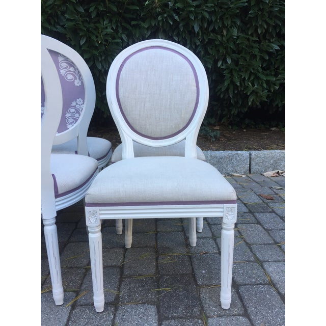 Set of 8 stunning Louis-style side chairs in Distressed White Oak with Belgian Linen upholstery featuring a stain...