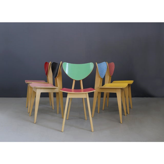Eccentric coloured ant set from the 50's. The structure of the set of chairs is made of cream-coloured lacquered wood....