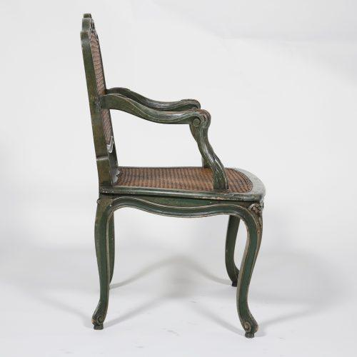 A handsome classic French green painted armchair from about 1840. The design was first made about 1720. The painted...