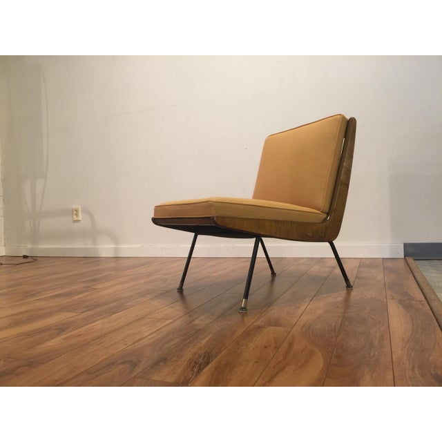 Mid-century modern boomerang chair with black metal legs and simple lines. It has been newly reupholstered in yellow...