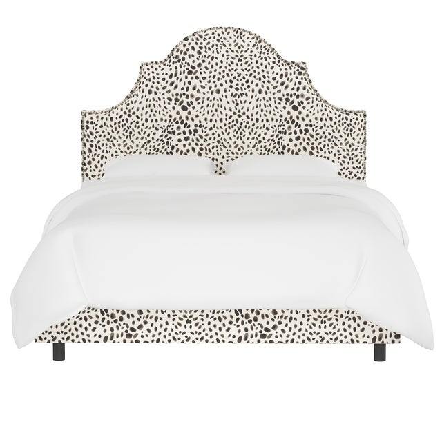 Classic curves wrapped in smooth upholstery, then accented with elegant ornamental nailheads, gives this Upholstered Bed...