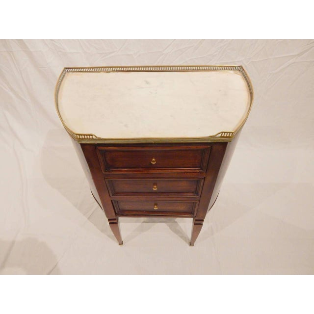 Elegant three-drawer walnut commode with white marble top and brass gallery trim. Restored with care. Circa 1860.