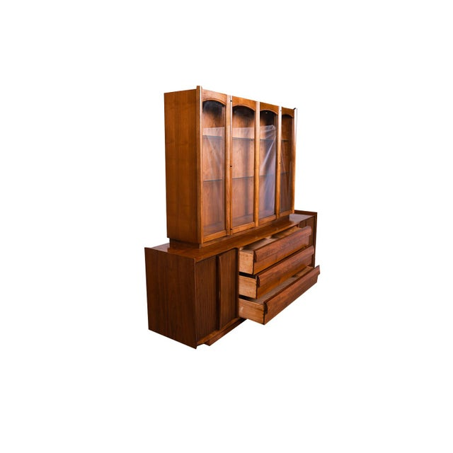 An elegant long Lane First Edition Mid-Century Modern sculpted walnut credenza/sideboard with detachable lighted hutch....