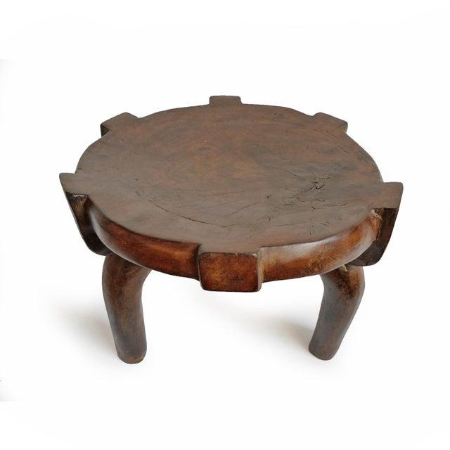 Original hand carved three legged wood stool from the Hehe tribal area of Tanzania. Beautiful patina and modern shape...