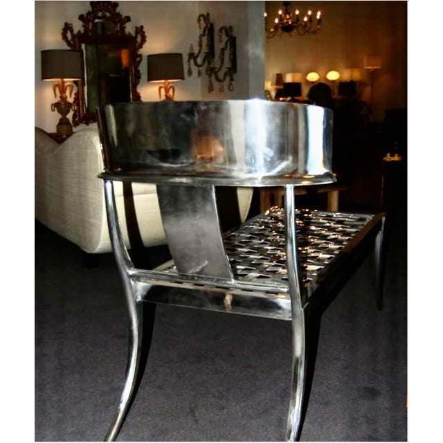Modern Klismos chaise lounge. The chaise lounge is made polished steel. The chaise is in flawless condition. The Klismos...
