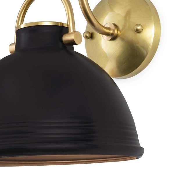 Combining beauty and utility, the classic shape of the ceramic Eloise sconce has all the makings of great design and...