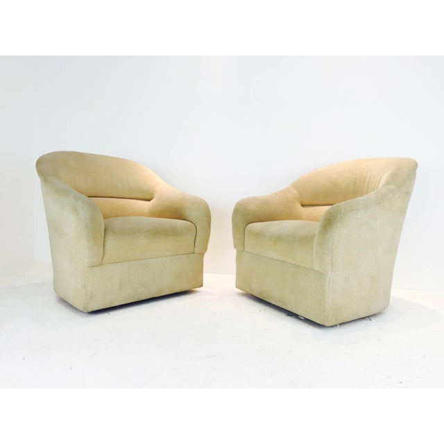 Pair of Ward Bennett barrel back club chairs. Original fabric. Reupholstery recommended. Wood legs.