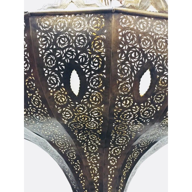 Oversize exquisite filigree pierced brass Moroccan chandelier. This exquisite Moroccan light fixture is delicately...
