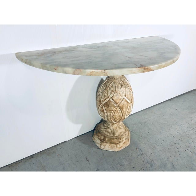 Sculpted plaster pineapple base with marble top demi lune table. From the 1970s.