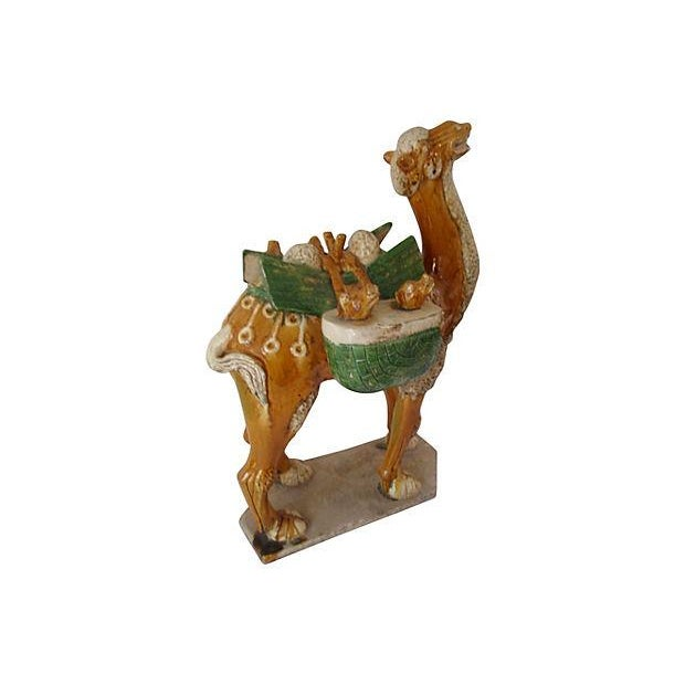 A wonderful large 19th-century Chinese Tang-style glazed camel. Some wear commensurate of age.