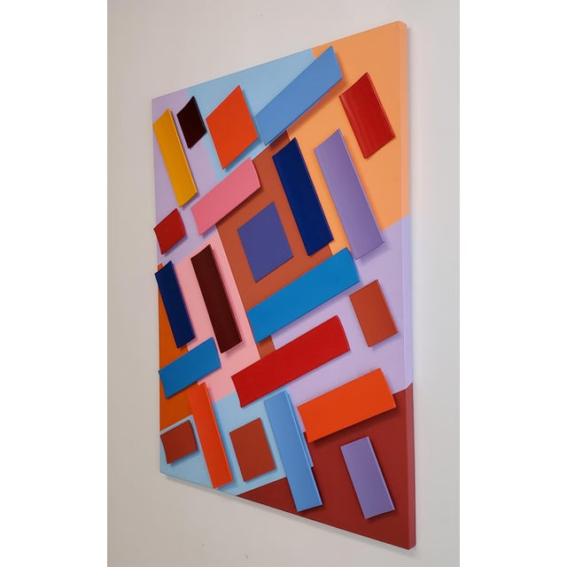 Wall hanging sculpture, bright colors evoke happiness and a positive mood.