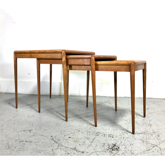 Exquisite set of three nesting tables designed by T.H. Robsjohn-Gibbings for Widdicomb. Mid-century modern tables...