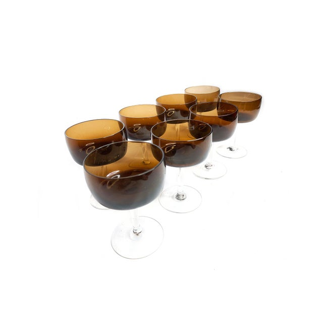 Vintage mid century modern 8 piece set of hand blown brown glass champagne glasses with clear glass stems. These coupes /...