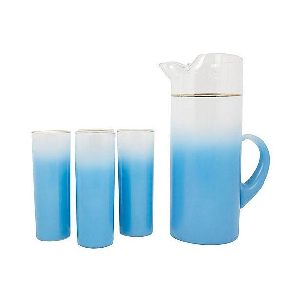"""Mid-century blue ombré pitcher and glasses set with gold-rim detail. No maker's mark. Glasses, 2.5""""Dia x 7""""H. Minor wear."""