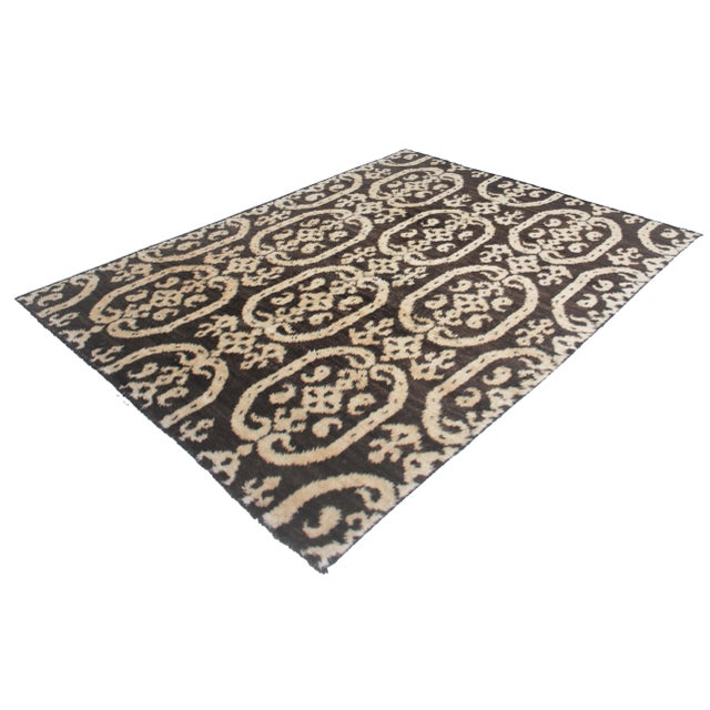 Beautiful handmade Ikat rug, by Aara Rugs. It's a rug with modern floral design and brown and ivory color, dyed with all...