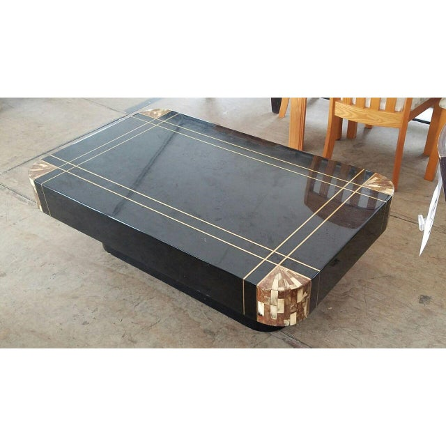 Chic Mid-century black lacquer inlaid brass and tessellated horn coffee table sold as found in very good vintage condition...