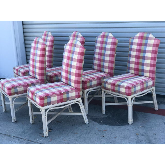 Set of 6 Ficks Reed hefty, well made upholstered rattan chairs with leather wrapping. Upholstery has some spots here and...