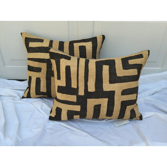 A pair of custom pillows in a vintage African raffia Kuba hand-sewn textile purchased at a flea market in France. Backed...