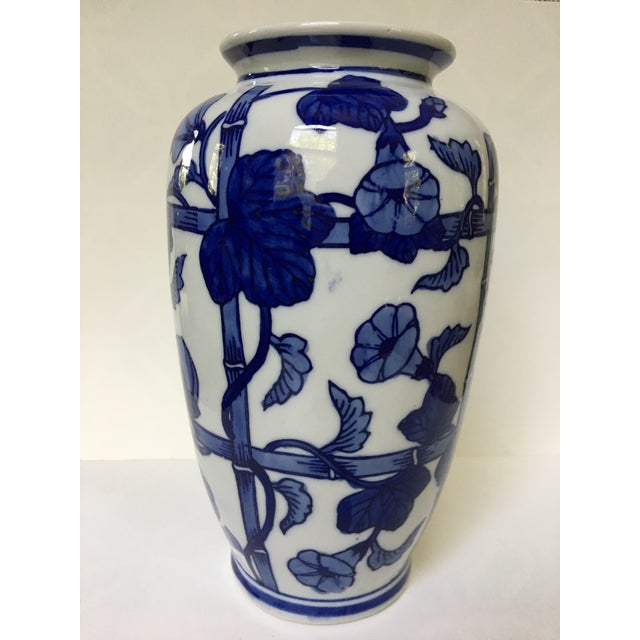 This is a lovely, blue and white porcelain vase in a bamboo and Morning Glory flower design. The piece was made by Vienna...
