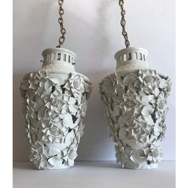 Pair of stunning Italian Blanc de Chine porcelain pendant chandeliers with exquisite floral details. Hollywood Regency...