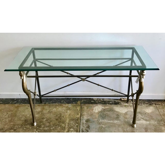 Super cool brass and beveled glass console with sea horse motif. A piece with true character and style.