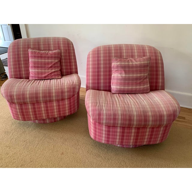Amazing pair of Directional Furniture rocking swivel chairs. These chairs are in their original pink plaid upholstery,...