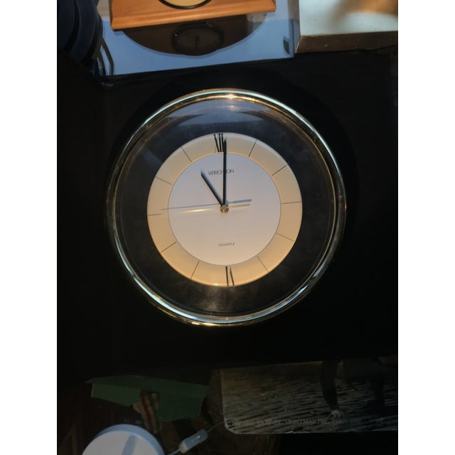 Vintage Memphis Lucite Modern Verichron Wall Clock. Lucite frame with brass edging, the center is tan and white with two...