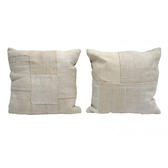 Ivory/white square cushion from patched antique cotton and linen kilim rugs. (Priced individually).
