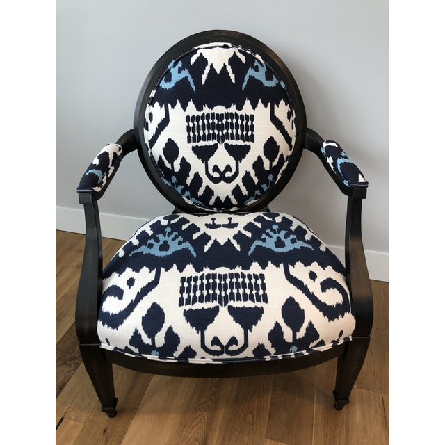 Quality medallion back lounge chair of matte ebonized hardwood upholstered in a gorgeous navy blue and white Ikat. Back...